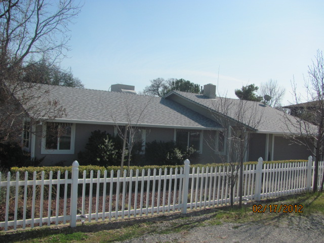 Installed new roof, siding, windows, doors, gutters and paint